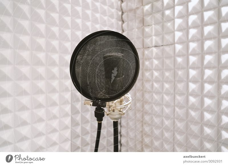 Microphone in speaker's booth Music Media Television Radio (broadcasting) Cinema White Recording studio Sound engineering soundproofed Tone microphone stand