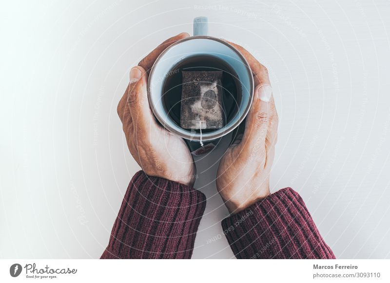 teacup between hands Human being Youth (Young adults) White Hand House (Residential Structure) Relaxation Winter Healthy Adults Think Living or residing