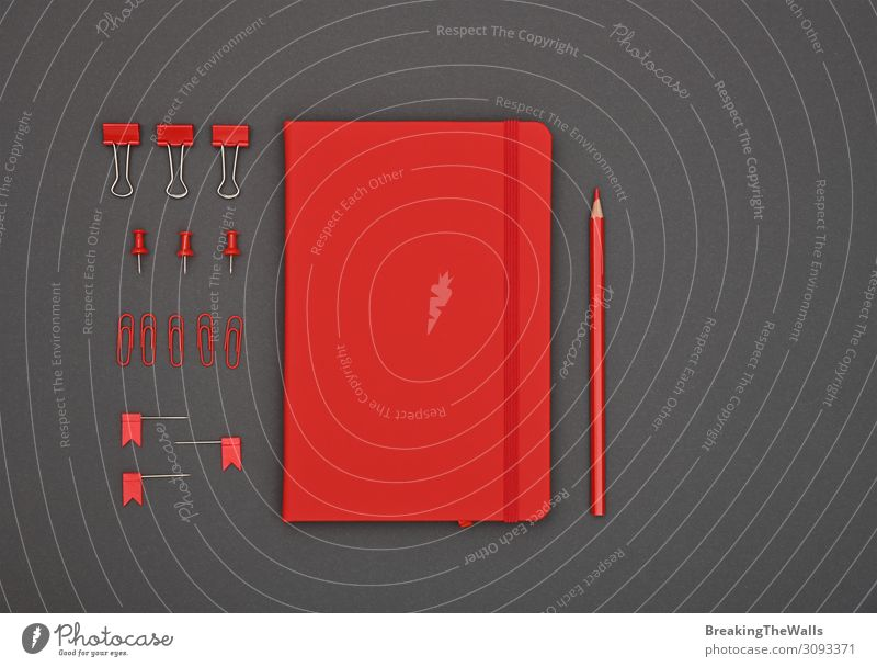 Neatly organized red stationery flat lay on grey Desk Table Workplace Office Stationery Paper Dark Modern Above Gray Red Black Colour Creativity Supply