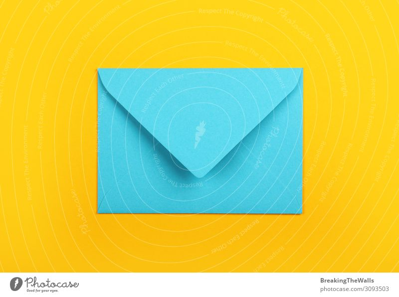 Closed blue paper envelope over yellow Office Mail Stationery Paper Modern Above Blue Yellow Colour Creativity pastel background post Communication Blank empty