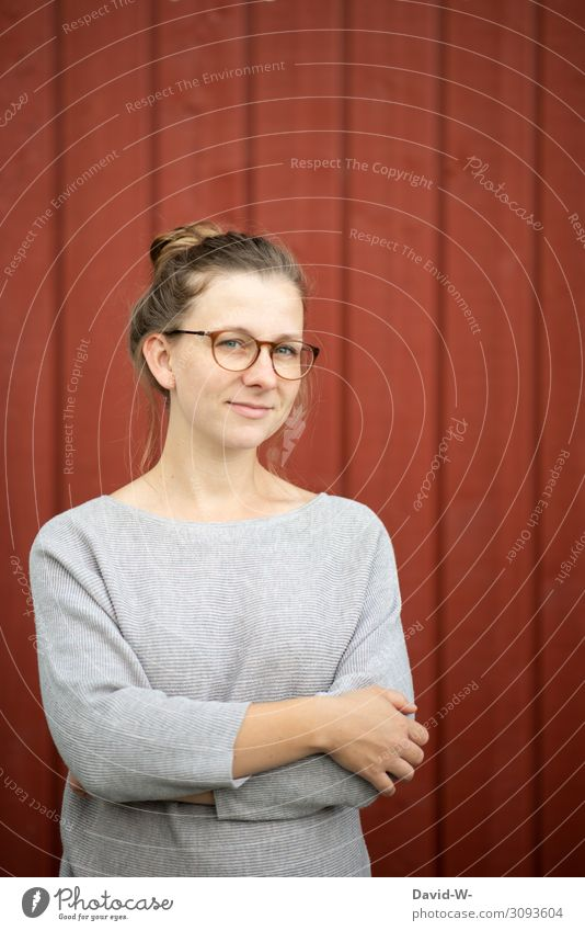 Young natural blonde woman smiles Woman Young woman smiled smilingly Blonde Friendliness Eyeglasses Wearer of glasses kind Positive red background