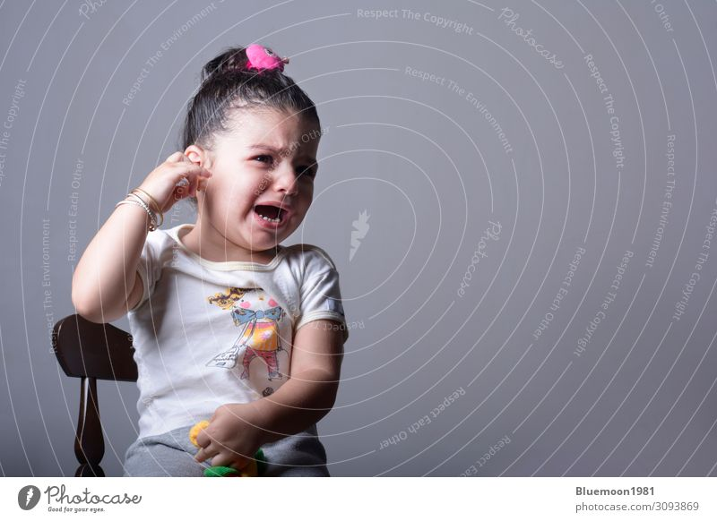 Lonely girl crying in front of gray background Lifestyle Face Healthy Illness Chair Child Human being Girl Infancy 1 1 - 3 years Toddler Wall (barrier)
