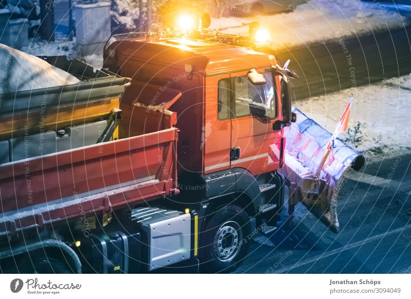 Winter road clearance vehicle with snow plough on the road Snowfall Transport Traffic infrastructure Street Car Truck Cold Red Black ice Smoothness Seasons