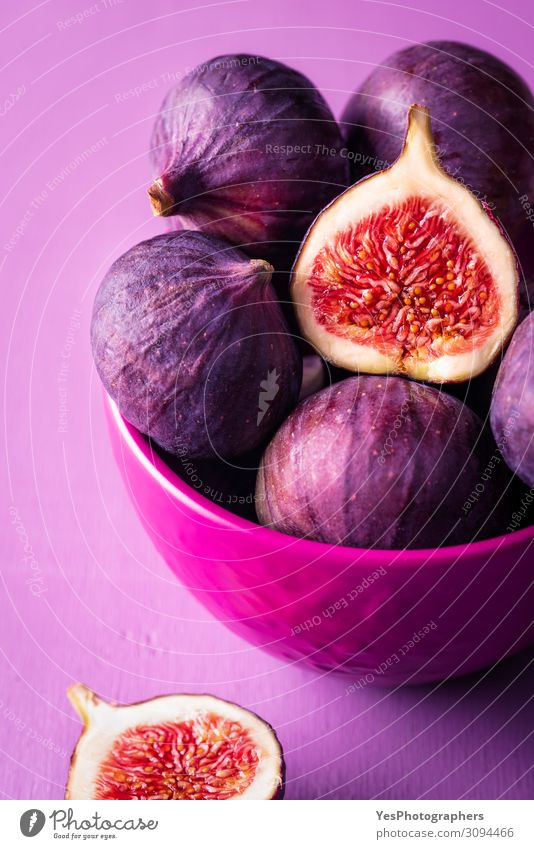 Fresh figs in a pink bowl. Figs close-up Fruit Dessert Nutrition Organic produce Vegetarian diet Diet Bowl Exotic Healthy Eating Delicious Juicy Violet Pink Red