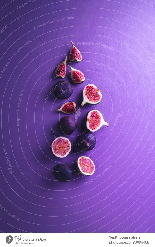 Fresh figs on a purple background. Sliced figs Healthy Eating Red Fruit Nutrition Delicious Vegetable Violet Dessert Vegetarian diet Diet Exotic Mature