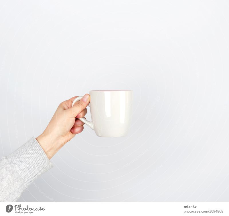 gray ceramic cup in female hand Breakfast Beverage Coffee Espresso Tea Cup Mug Design Kitchen Human being Woman Adults Arm Hand Fingers Container Hot Gray White