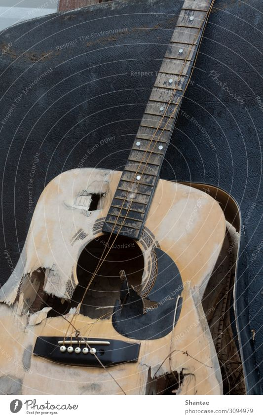 Destroyed Guitar Musician Art Culture Musical notes Musical instrument string Wood Utilize Sadness Aggression Old Broken Rebellious Trashy Gray Moody Pain