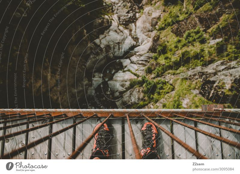 abyss Leisure and hobbies Adventure Mountain Hiking Human being Feet Nature Landscape Summer Beautiful weather Rock Alps Hiking boots Observe Stand Tall