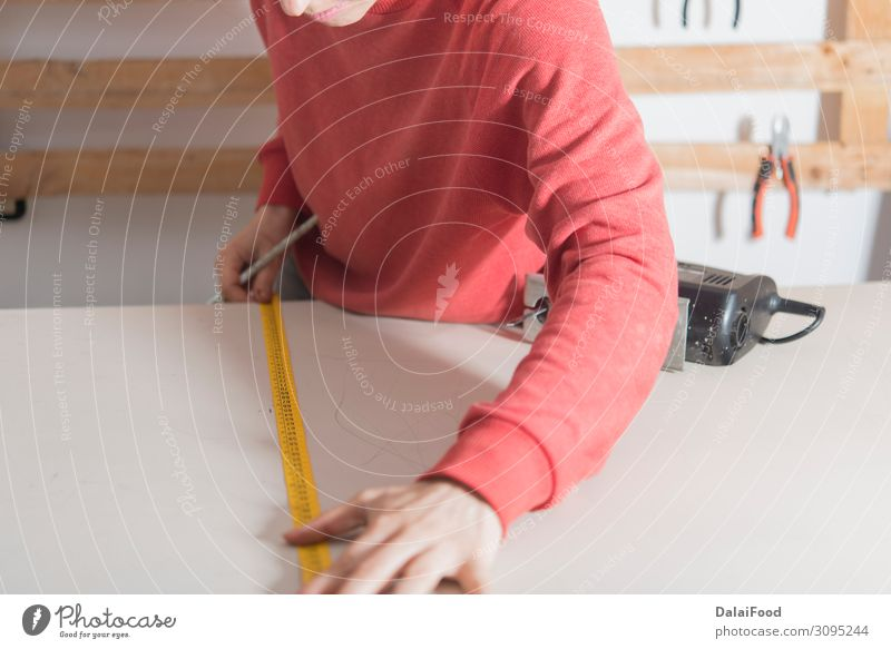woman with tape measure ready to cut a wood Work and employment Profession Industry Business Tool Human being Woman Adults Hand Building Cloth Gloves Wood Old
