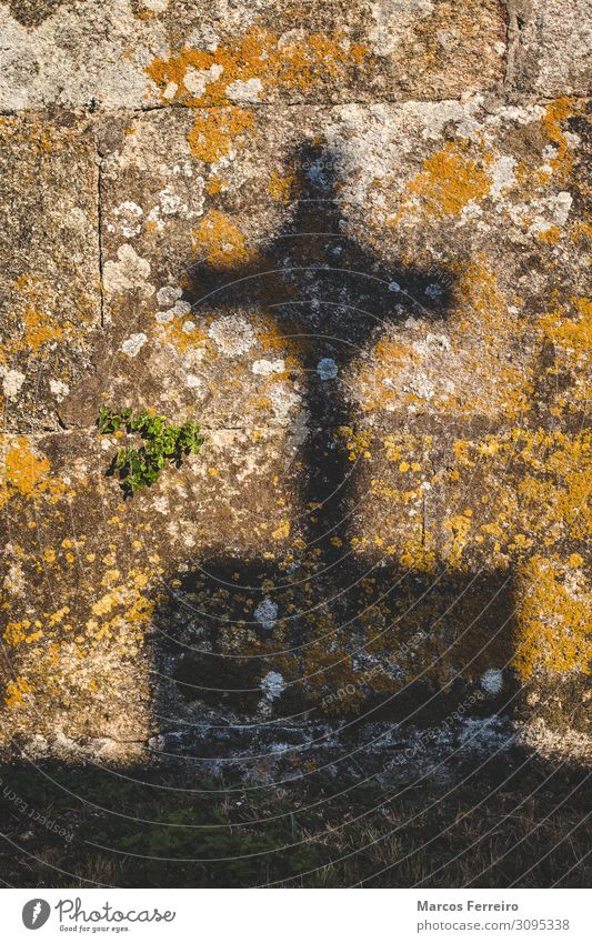 crucifix shadow on stone wall Art Sculpture Sun Church Monument Stone Sign Crucifix Old Historic Retro Death End Serene Religion and faith light tombstone