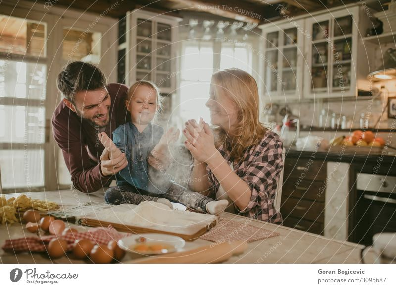 Happy family making pasta in the kitchen Joy Table Kitchen Child Human being Girl Woman Adults Man Family & Relations Infancy 3 Love Make Together Small