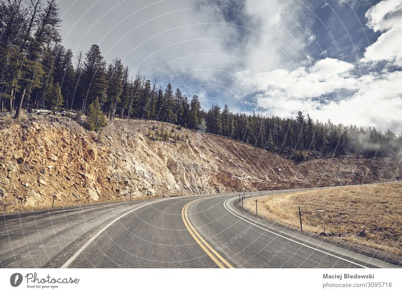 Mountain road bend in Yellowstone National Park, USA. Vacation & Travel Trip Nature Landscape Sky Autumn Hill Street Adventure Experience Freedom Wyoming