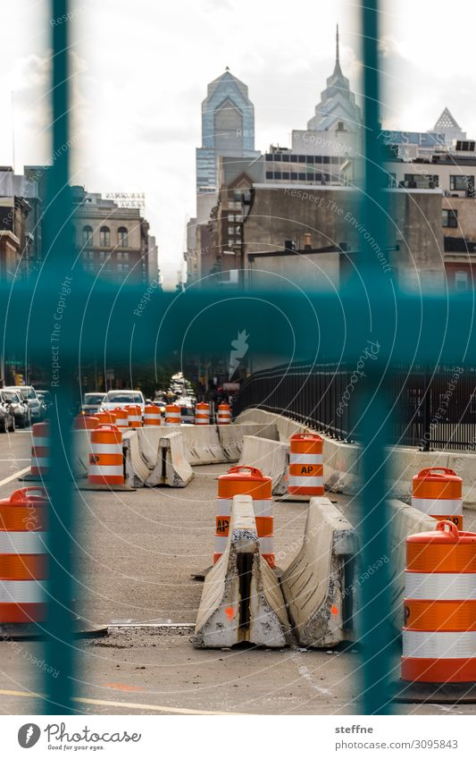 vertical Downtown Skyline High-rise Transport Street Crossroads Town Barrier Roadblock Construction site Fence Traffic cone Philadelphia USA Colour photo