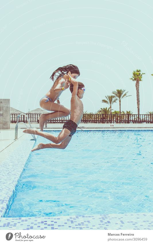 kids jumping into the pool Child Human being Vacation & Travel Summer Water Sun Joy Girl Lifestyle Sports Boy (child) Swimming & Bathing Jump Body Infancy