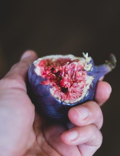 Sweet to bite with Food Fruit Nutrition Eating Organic produce Slow food Healthy Eating Hand Eroticism Fresh Delicious Juicy Brown Violet Pink Red Lust Fig Dish
