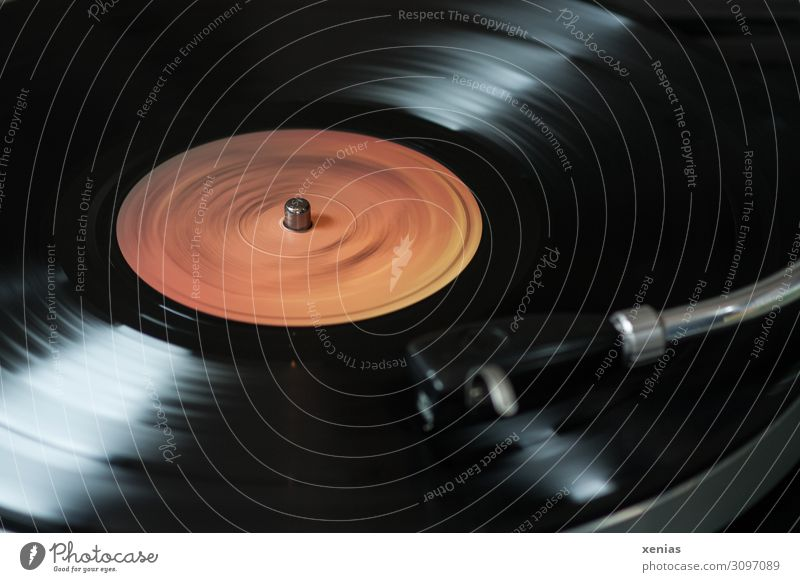 Record plays...and plays Record player Entertainment electronics Advancement Future Music Media Rotate Listening Old Dark Orange Black vintage Detail