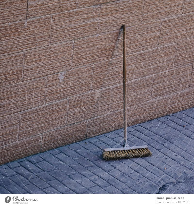 wooden broom on the wall for cleaning the street Broom Wood Clean Tool Brush Object photography Sweep Equipment Story Dust handle Wall (building) Cleaner Old