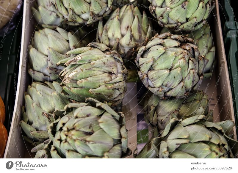 Artichokes in a market Vegetable Fruit Nutrition Vegetarian diet Diet Summer Garden Nature Plant Flower Leaf Stand Fresh Delicious Natural Green Colour