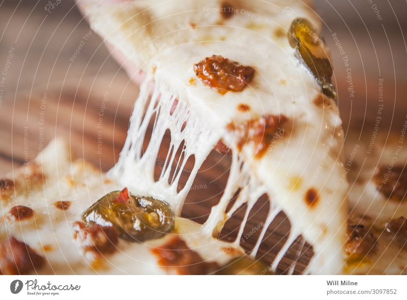 Slice of Pizza with Cheese Pull Food photograph Dish Delicious Dinner Meat Lunch Stretching Pepper Italian Gourmet Dairy