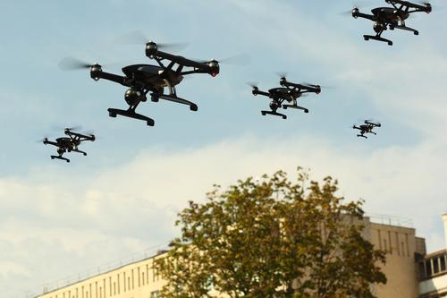 Swarm of Unmanned Aircraft System (UAV) Quadcopters Drones Black Flying Aviation Aggression Means of transport Apocalyptic sentiment