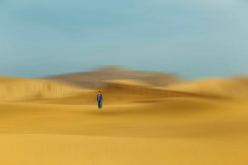man in desert dunes , china Human being Sky Nature Man Landscape Relaxation Clouds Loneliness Lifestyle Adults Autumn Emotions Sand Contentment Park Body