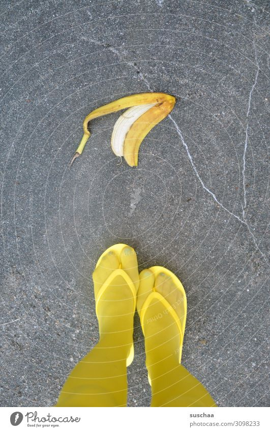 banana skin Banana Banana skin Throw away Dangerous Accident Testing & Control Slip Street Asphalt Pedestrian feet Legs Yellow Woman feminine Stockings