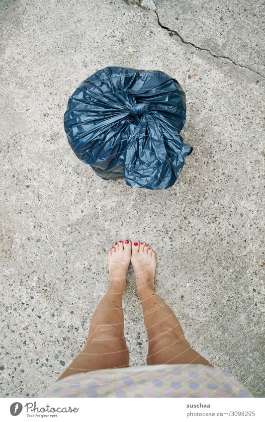 female legs in front of blue garbage bag Trash plastic Environmental pollution Plastic waste Trash container Plastic bag waste disposal Climate change Woman