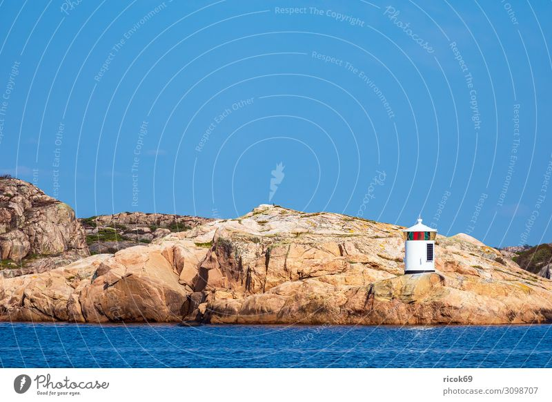 Lighthouse on an archipelago island off the town of Fjällbacka Relaxation Vacation & Travel Tourism Summer Ocean Island Nature Landscape Water Clouds Rock Coast