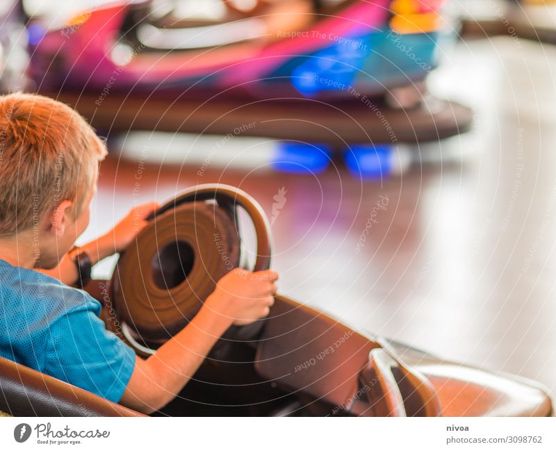 Boy drives a bumper car Leisure and hobbies Playing Vacation & Travel Trip Adventure Freedom Bumper car Night life Entertainment electronics Boy (child) 1