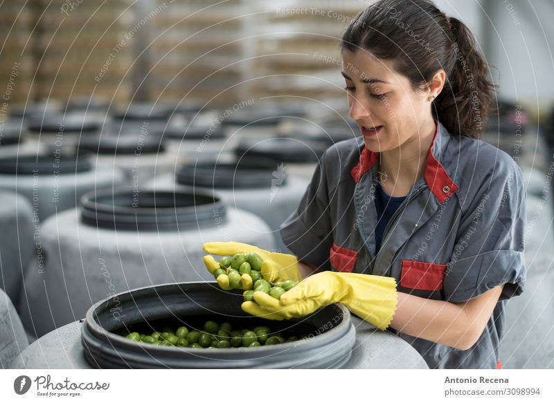 Quality! Fruit Work and employment Profession Workplace Factory Industry Technology Human being Woman Adults Gloves Brunette Packaging Smiling Stand Clean