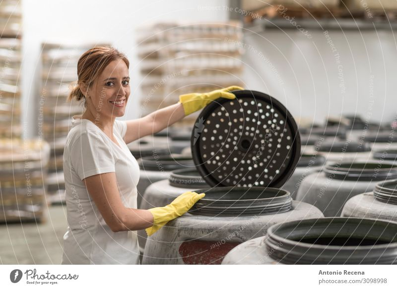 Woman looking at camera and smiling in olives fermentation factory Fruit Work and employment Workplace Factory Industry Business Company Human being Adults