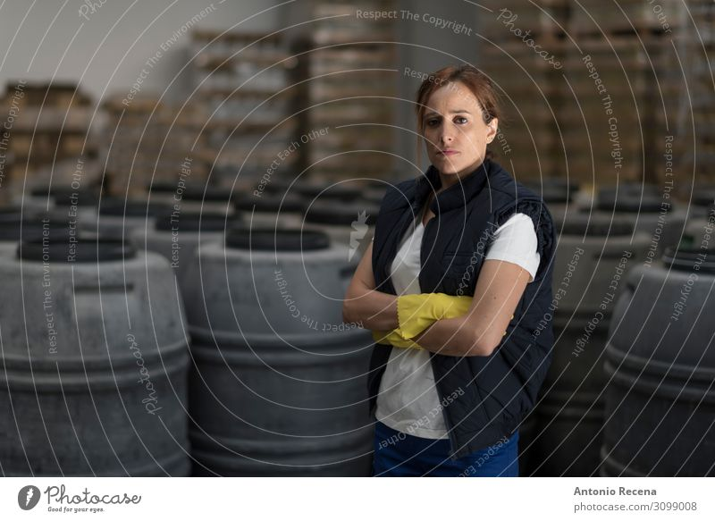 Woman posing in olives factory Lifestyle Work and employment Factory Industry Human being Adults Partner Plant Stand Dark Serene Employees & Colleagues food