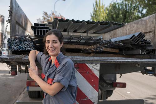 she is trucker Woman Human being Adults Business Work and employment Transport Smiling Stand Industry Protection Posture Profession Near Factory Material