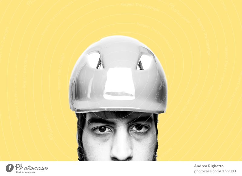 Concept of hating own job, stressed at work, unhappy of his job. Portrait of a sad, unhappy caucasian male factory worker wearing an helmet. Black and white subject with yellow background