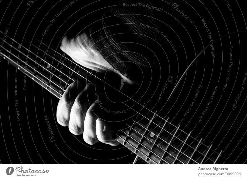 Hand holding an acoustic guitar with black background with a dramatic and cinematic tone in chiaroscuro Man Adults Art Artist Exhibition Culture Youth culture