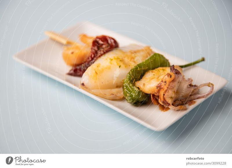 Spanish tapas. Dinner Diet Plate Ocean Table Restaurant Fresh White Tasty Squid fish mediterranean food chef cook BBQ cuttlefish Snack market flavor fat-free