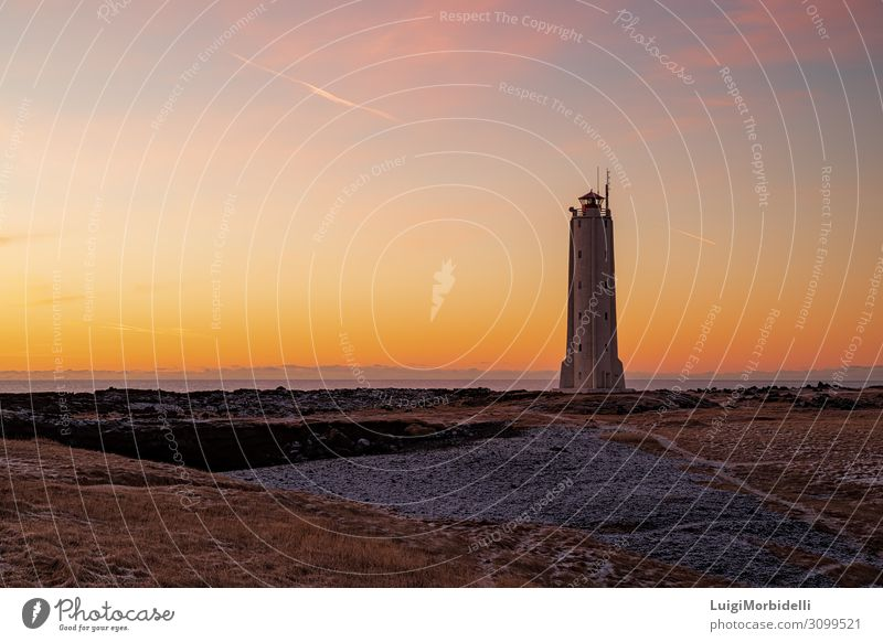 Malarrif lighthouse at sunset, Iceland Vacation & Travel Tourism Ocean Island Snow Nature Landscape Sky Lighthouse Natural Orange Red Colour malarrif