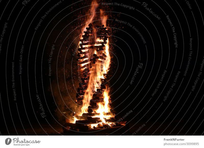 burning twist Art Sculpture Culture Elements Fire Wood Hot Warmth Yellow Gold Black Colour photo Exterior shot Deserted Copy Space left Copy Space right Night