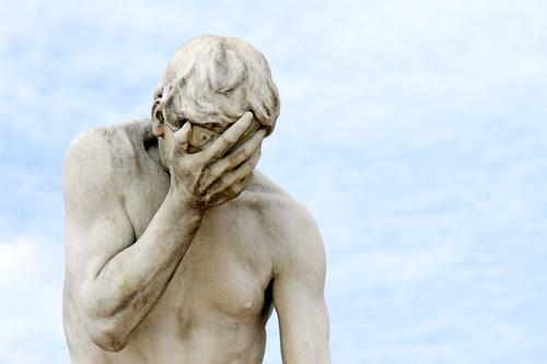 Facepalm - Statue holds a hand in front of the face Masculine Sky Monument Stone Sadness Concern weaker Shame Remorse Fear of the future Stress Distress