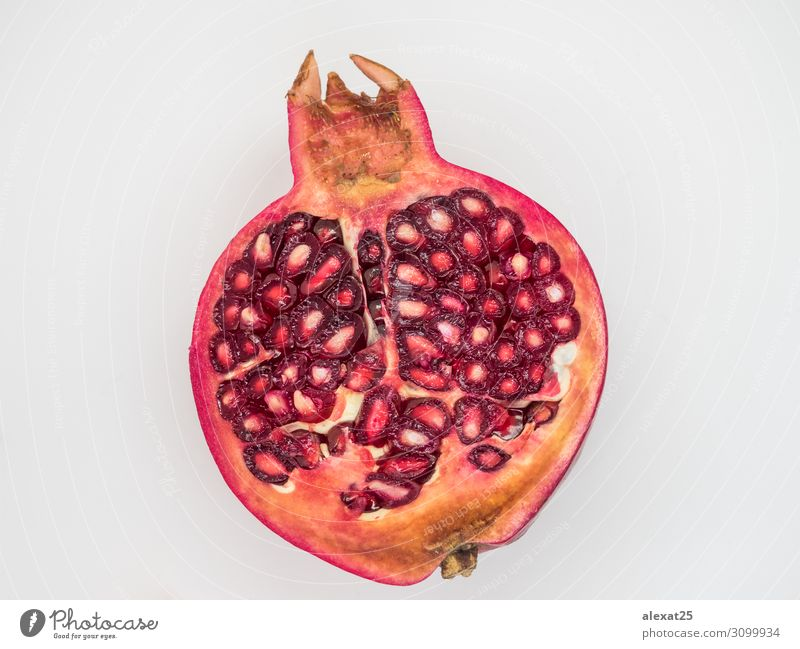 Half pomegranate isolated Fruit Dessert Vegetarian diet Diet Nature Fresh Natural Juicy Red White background Cut food healthy Ingredients Organic piece
