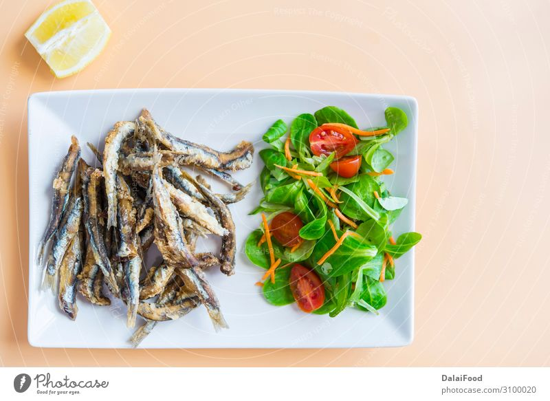 Fried sardines (fish) pescaito frito typical spanish tapa Seafood Bread Lunch Dinner Diet Plate Wood Fresh Blue White anchovies anchovy appetizer background