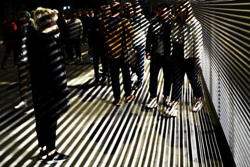 Light and shadow Human being Friendship Couple Life Crowd of people 30 - 45 years Adults Movement Feasts & Celebrations Going Colour photo Exterior shot Night
