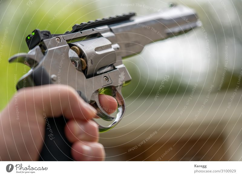 in one hand is large silver heavy revolver and aims into the air Roulette Human being Masculine Young man Youth (Young adults) Hand 1 8 - 13 years Child Infancy