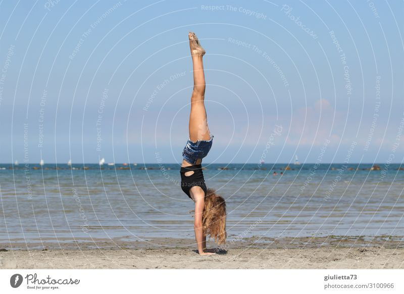 sensitivity + strength + balance = handstand Young woman Youth (Young adults) Life 1 Human being 13 - 18 years Cloudless sky Summer Beautiful weather Coast