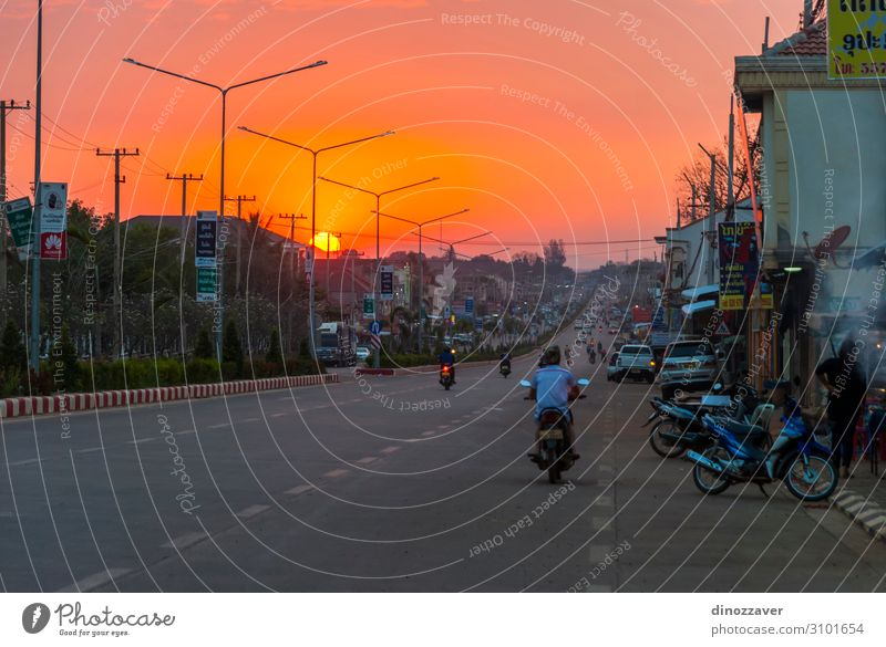 Pakse main road in sunset, Laos Shopping Beautiful Vacation & Travel Summer Sun Lamp Culture Nature Landscape Sky Tree Hill Town Architecture Transport Street