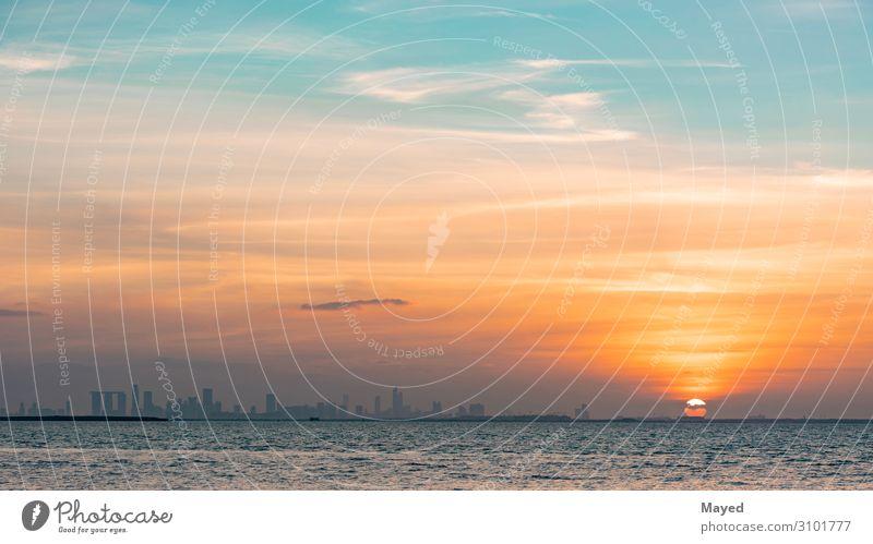 Abu dhabi skyline Newspaper Magazine Environment Landscape Water Sky Clouds Horizon Sun Climate Beautiful weather Waves Coast Abu Dhabi United Arab Emirates