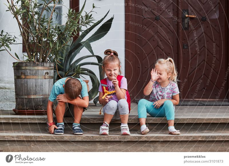 Children making silly faces Joy Happy Face Playing Sister Make Sit Authentic Funny Cute Crazy Emotions girl kid Gesture sign preschooler sibling brother people
