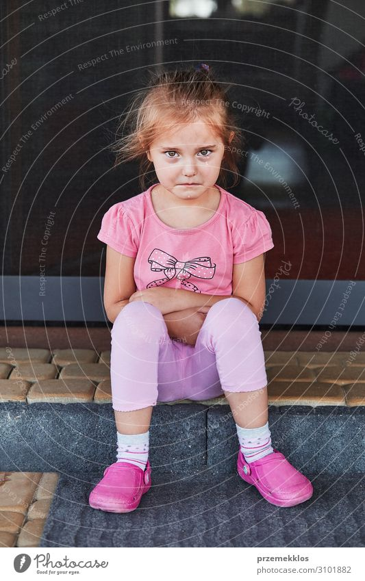 Little sad girl crying because of lost her toy, sitting on a step on the patio. Real people, authentic situations Child Human being Girl Infancy 1 3 - 8 years
