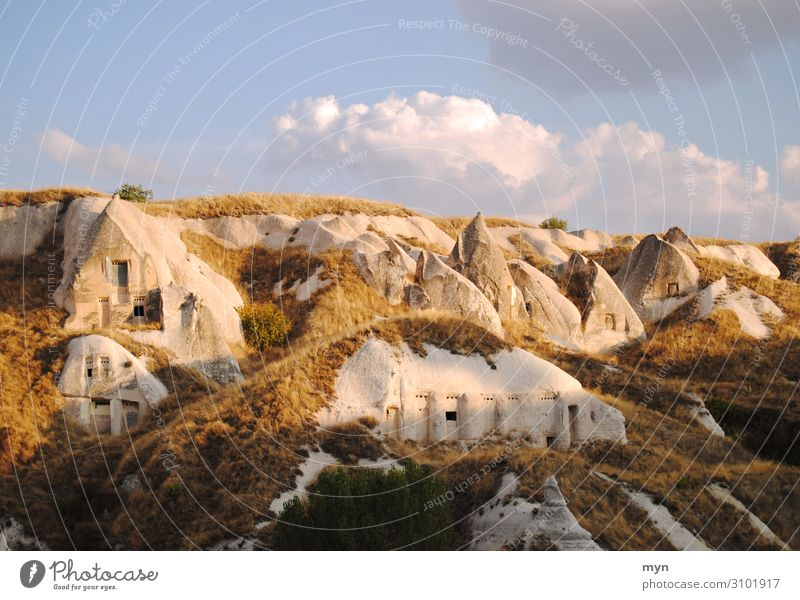 Caves in Cappadocia Valley Tourist Attraction tuff rock Landscape Sky rocky landscape Rock Stone Mountain Vacation & Travel Tourism Sandstone Anatolia Hill