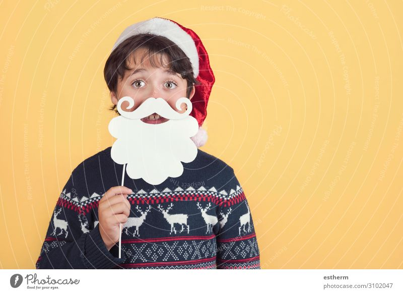 Child Wearing Christmas Santa Claus Hat and beard on yellow background Lifestyle Joy Winter Feasts & Celebrations Christmas & Advent New Year's Eve Human being